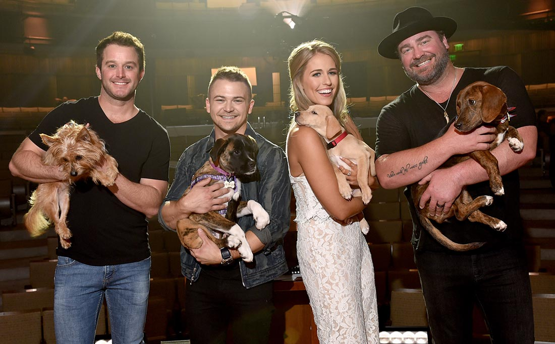 Easton Corbin, Hunter Hayes, Jillian Cardarelli and Lee Brice all holding rescue dogs
