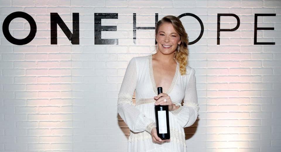 LeAnn Rimes holding bottle of wine